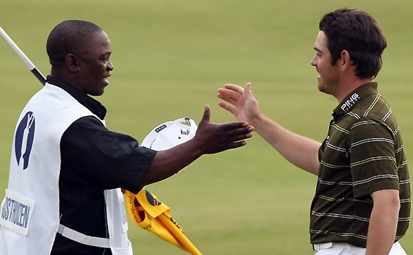 Caddie Zack Rasego and Louis Oosthuizen