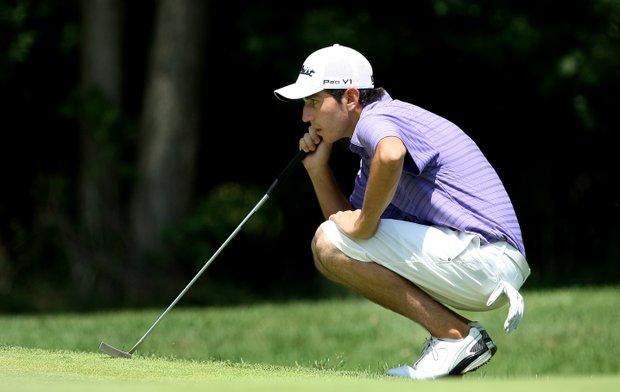 Anthony Paolucci lines up his putt at No. 10. Paolucci defeated Dan Slavin, 3 and 1.