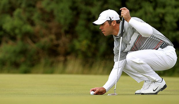 England's Paul Casey lines up a putt during round four of The Open Championship at St. Andrews.