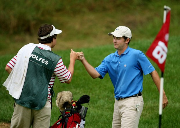 Scott Wolfes fist bumps with his caddie Weston Rawls after making par at No. 18 to extend the match during Thursday's Round of 16. Wolfes beat Zachary Wright to move to Quarterfinals.