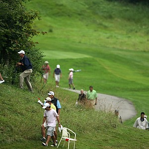 Jorge Fernandez Valdes heads into the woods at No. 18 in search of his ball during Thursday's Round of 16. Valdes conceded and lost the match at No. 18.