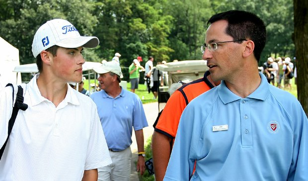 Gavin Hall walks with head pro Jim Amiot after shooting a U.S. Junior Amateur-record 62.