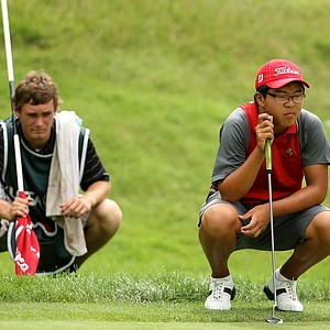 Jim Liu, right, looks over his putt at No. 17 during the quarterfinals. Lie defeated Gavin Hall, 1 up.