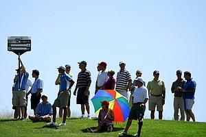 Spectators gather on the hill at No. 9 to watch the Robby Shelton vs. Jim Liu match during the semifinals.