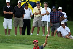 Jim Liu reacts to dropping a 40 foot putt at No. 14 during the semifinals against Robby Shelton.