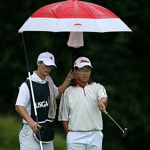 Jim Liu with his caddie Branden Miklosovic at No. 9.