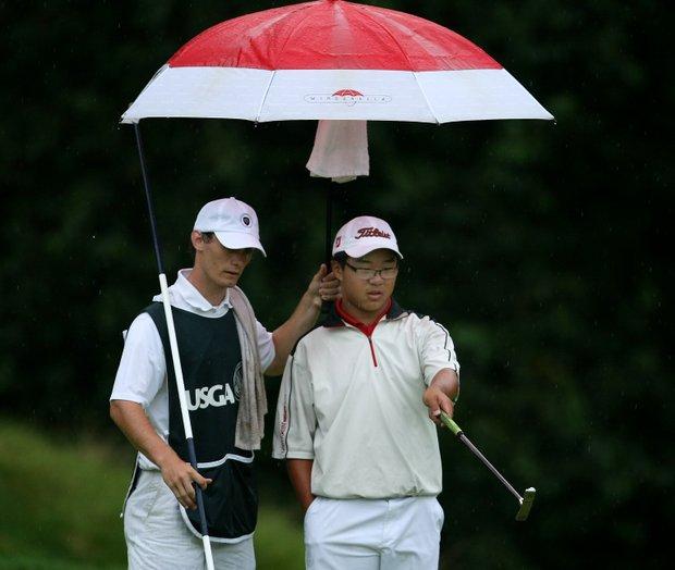 Jim Liu with his caddie Branden Miklosovic at No. 9.