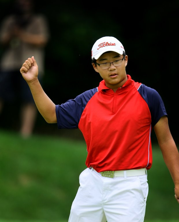 Jim Liu pumps his fist at No. 7, the 25th hole, after making birdie during the finals.