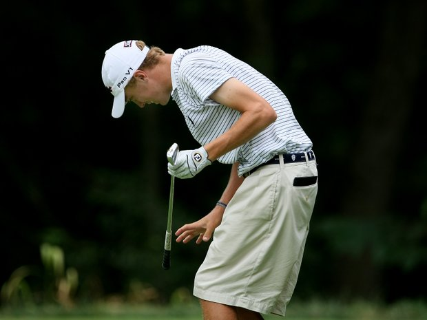 Justin Thomas grimaces after his tee shot at No. 8, the 26th hole, during the finals.
