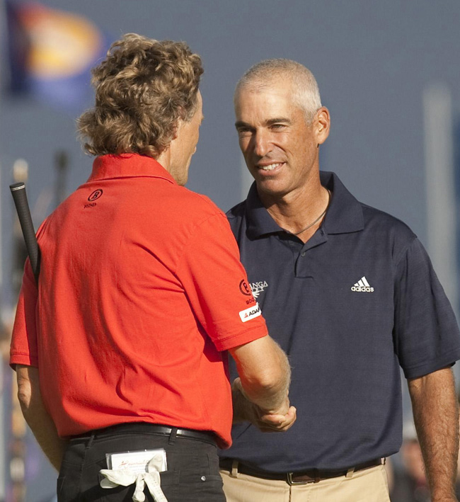 Germany's Bernhard Langer (left) is congratulated by American Corey Pavin after the British Senior Open at Carnoustie Golf Club.