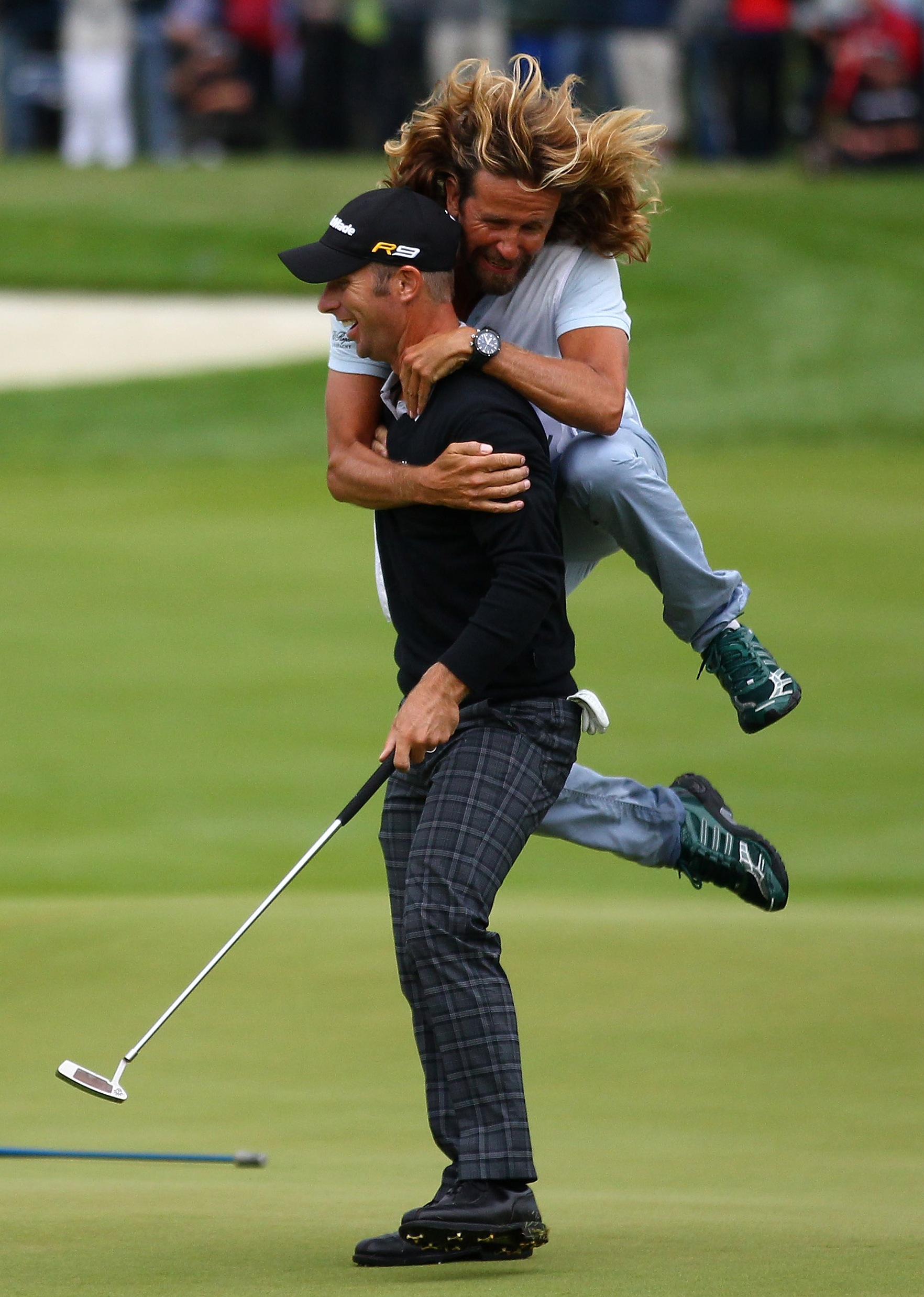 Richard S. Johnson celebrates with his caddie after winning the Scandinavian Masters.
