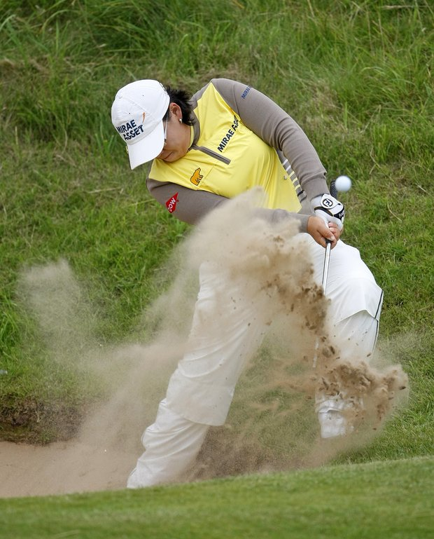 Jiyai Shin plays out of a bunker on the second hole during the first round of the Women's British Open.