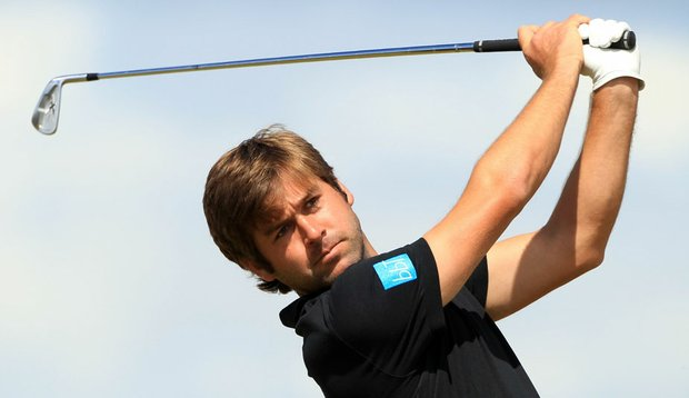 Robert Rock hits a tee shot at the British Open