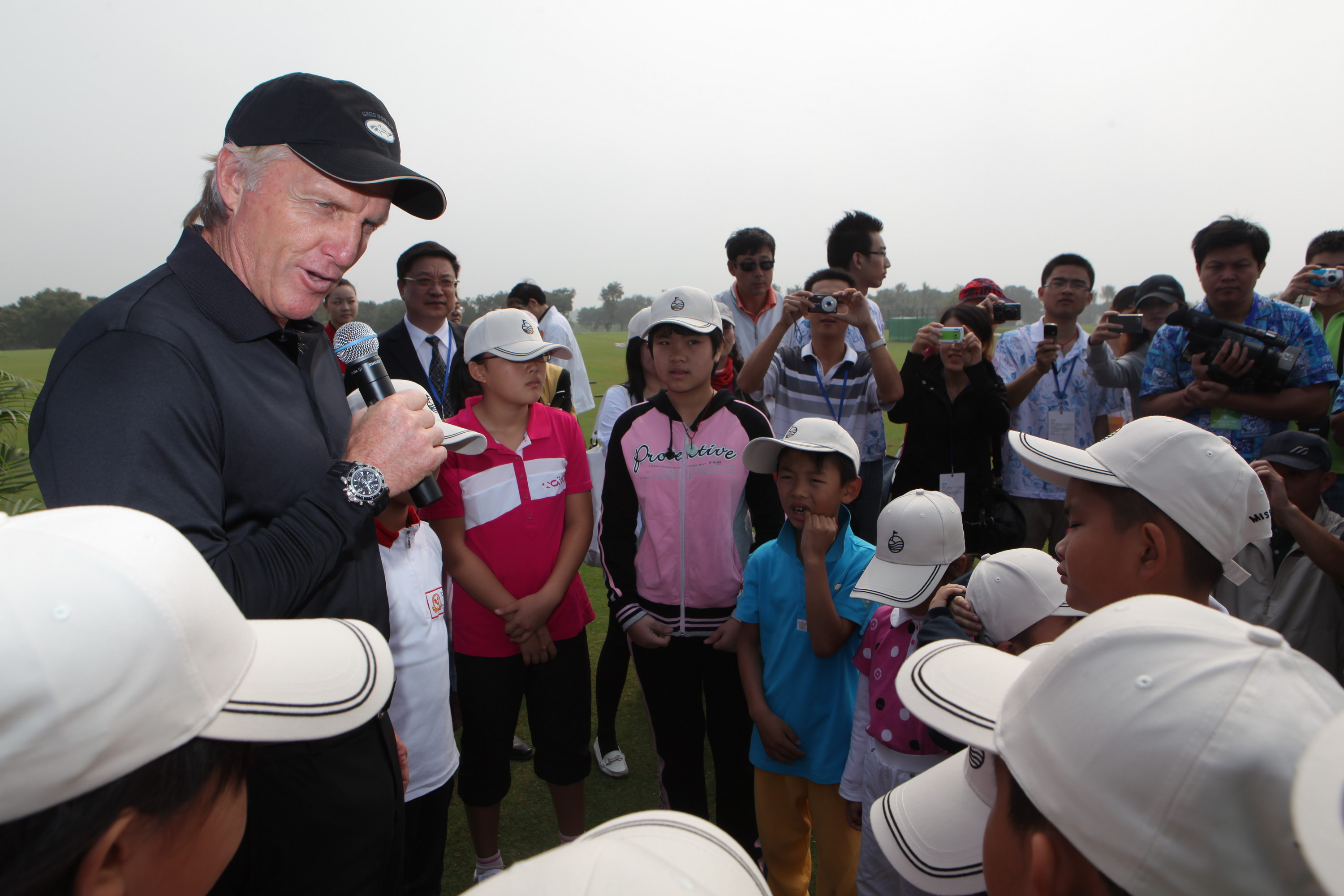 Greg Norman with junior golfers during a visit to Mission Hills Golf Club China.