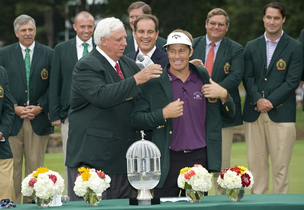 Stuart Appleby (left) receives the winner's jacket from Jim Justice after winning the Greenbrier Classic.