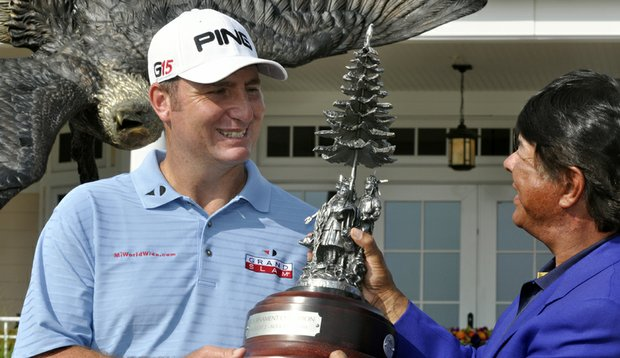 Bill Lunde, left, receives the trophy from Ray Halbritter, CEO of Turning Stone Resort, after winning the Turning Stone Resort Championship.