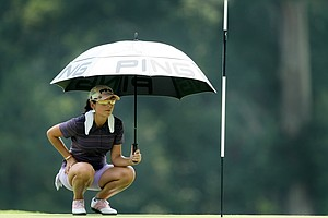 Juliana Murcia hides from the heat of the sun at No. 3 during Monday stroke play.
