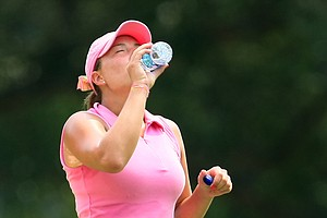 Calle Nielson tries to stay hydrated during Monday stroke play.