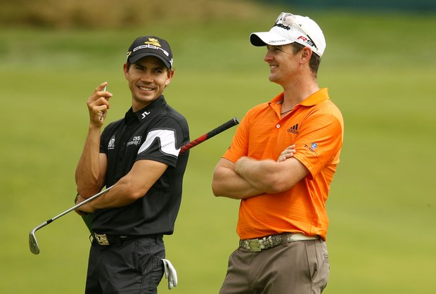 Camilo Villegas, left, and Justin Rose wait on a green during a practice round prior to the start of the 92nd PGA Championship.