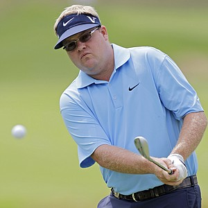 Carl Pettersson chips during a practice round for the PGA Championship.