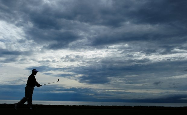 Darren Clarke hits a shot during a practice round prior to the start of the 92nd PGA Championship at Whistling Straits.