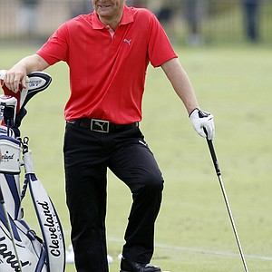 Soren Kjeldsen takes a break while hitting balls on the driving range during a practice round for the PGA Championship.