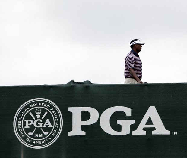 Vijay Singh walks across a bridge during a practice round for the PGA Championship.