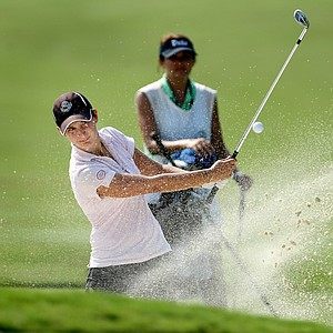 Lindy Duncan hits out of a bunker at No. 9. Duncan shot rounds of 75, 78.