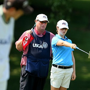 Candace Schepperle with her father/caddie, David, look over her putt at No. 9. Schepperle shot a 75 on Tuesday.