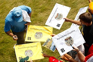 Chip Sullivan signs his autograph for fans during a practice round at PGA Championship.