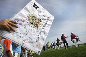 A fan waves a flag, hoping for an autograph Aug. 10 at the PGA Championship.