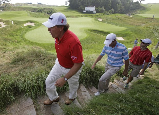 Phil Mickelson, left, and Sean O'Hair walk off the 18th hole during a practice round for the PGA Championship.