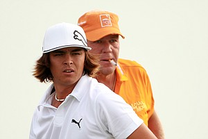 Rickie Fowler and John Daly look on during a practice round at the PGA Championship.