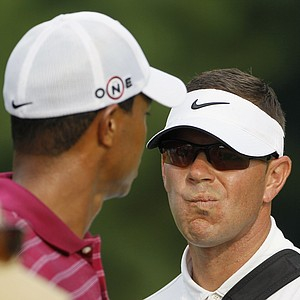 Instructor Sean Foley talks with Tiger Woods on Aug. 10 at the PGA Championship.