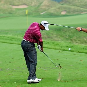 Tiger Woods works on his swing with his caddie Steve Williams during a practice round prior to the start of the PGA Championship.