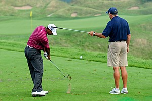Tiger Woods works on his golf swing with caddie Steve Williams at the PGA Championship.