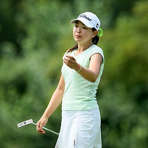 Tiffany Lua reacts to her putt at No. 17. Lua lost to fellow Curtis Cup teammate Cydney Clanton.