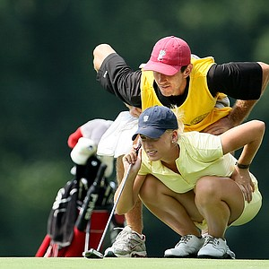 Brooke Pancake  lines up a putt at No. 4 with her caddie. Pancake lost to Corrine Carr in 20 holes.