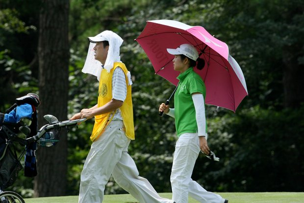 Jungeun Han and her father/caddie at No. 8, keep cool while defeating Amy Anderson 7&5.