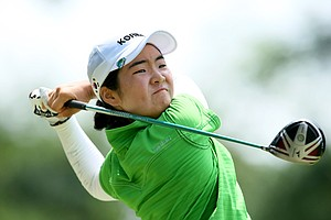 Jungeun Han watches her tee shot at No. 8. Han made a par.
