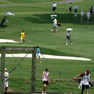 Players and spectators on the course during Wednesday's Round of 64 at the 2010 Women's Amateur at Charlotte Country Club.
