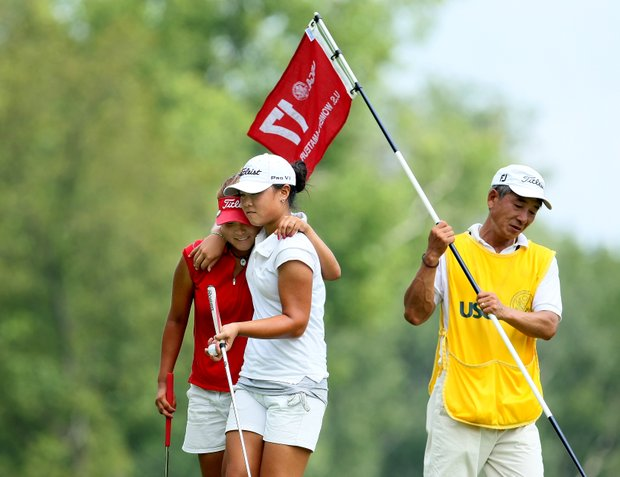 Danielle Kang, right, and Grace Na, embrace after Kang won 1 up during Wednesday's Round of 64. The two will be teammates at Pepperdine next fall.