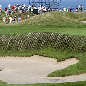 Graeme McDowell hits to the 11th green during a practice round for the PGA Championship.