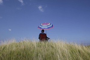 A fan watches a practice round at the PGA Championship.
