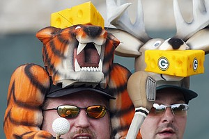 Fans watch the action during a practice round for the PGA Championship.