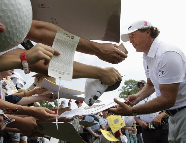 Phil Mickelson signs autographs Wednesday at the PGA Championship.