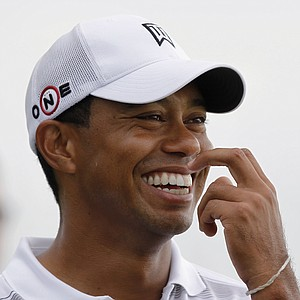Tiger Woods laughs as he waits on the 16th tee during a practice round for the PGA Championship.