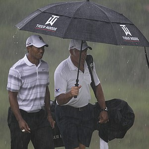 Tiger Woods and caddie Steve Williams walk up the 18th hole during a practice round for the PGA Championship.