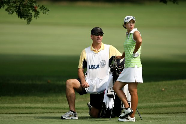 Marina Alex with her college coach/caddie, Greg Allen, waits to hit a shot during Thursday's  Round of 32. Alex knocked out Rachel Rohanna in 19 holes, then lost in 20 holes to Kristen Park.