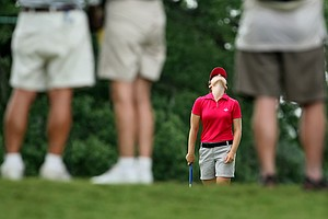 Candace Schepperle can be seen reacting to her putt through the legs of spectators at No. 8. Schepperle lost to Korda in the Round of 32.